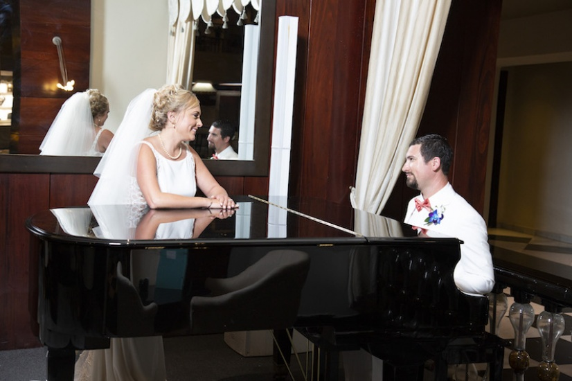 Couple at piano - Wedding Photographers in Jamaica